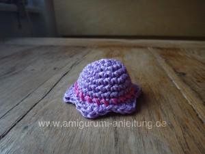 Der gehäkelte Hut sehr auch wie eine Campanula Blume
